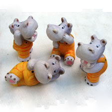Set of Four Hippo Figurines